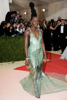 Lupita Nyong'o wore a Calvin Klein Collection gown, designed in collaboration with The Green Carpet Challenge , and jewellery by Tiffany & Co.