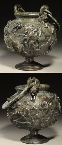 ROMAN BRONZE BALSAMARIUM: HUNTING SCENE:  In very high relief covering the spherical body. Two equestrians, one falling off horse, with wild animals (lion, bear, panther, stag, and boar) and dogs in superb detail. On a pedestal foot; two loop rings with animal protomes at the lip to attach the swing handle. Superb style; olive green patina. A masterwork!  Later 2nd Century AD