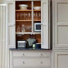 Kitchen glass chimney hood gray backsplash kitchen ideas for Bi fold doors for kitchen cabinets