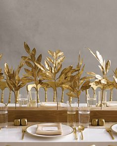 Branch and Leaf Centerpiece: Juxtapose opulent gold branches (in the form of faux bay-laurel twigs) with the humble grace of wood (apply gold Rub 'n Buff and drill holes) for a decadent yet simple centerpiece. - from Nonfloral Wedding Centerpieces. Non Floral Centerpieces, Wedding Centerpieces, Floral Arrangements, Flower Arrangement, Holiday Centerpieces, Centrepieces, Centerpiece Ideas, Branch Centerpieces, Holiday Tablescape