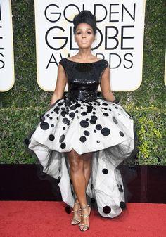 Wearing an Armani asymmetrical dress, Giuseppe Zanotti heels, and Forevermark jewels.              Image So...