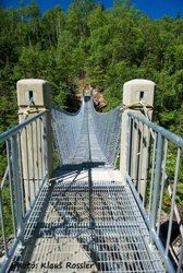 """Pukaskwa National Park in Ontario. This must be a new bridge.the old one swung quite a bit and had chicken wire under the wooden slats :/ we called this hike to the white river """"the death march"""" Camping Places, Places To Travel, Modern City, Rv Travel, Lake Superior, Covered Bridges, Hiking Trails, Outdoor Activities, Kayaking"""