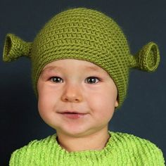 okay the kid is funny lookin, but the hat is hilarious and too cute.