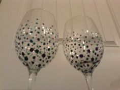 Set of two decorated wine glasses by thisisourname on Etsy, $8.00