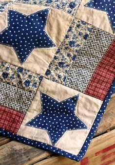Patriotic vintage looking quilt with blue star applique.  I love, love, love this quilt.