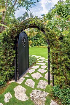 """The Entry - Magnificent Miami Garden - Southernliving. This garden reads like a mystery novel. Peer through the open gate at the coral stone path that leads from the parking area behind the house, and you are hooked. You must discover what surprises lie beyond. The fact that you can't see everything from this one spot or any other is intentional. """"There's nothing more boring than entering a house or garden and seeing it all,"""" states Jorge Sanchez. """"We like to make you walk from one space to…"""