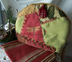Crazy Quilt Style Tea Cozy, could practice some hand embroidery along the seam lines.