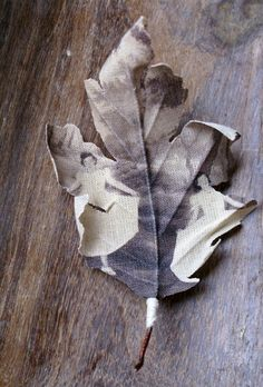 Old photos printed on cotton and then sculpted into leaf shapes.