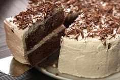 Tres Leches de Ron con Chocolate (Chocolate Rum Tres Leches Cake)Can tres leches cake be improved upon? This version ups the ante with the addition of coffee, cocoa, chocolate, and a healthy dose of booze.