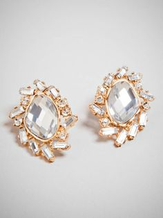 A little bit quirky and a lot of polish, these statement studs pack a  punch.  Mixed shape crystals are strewn about an oversized gem in a purposefully offbeat way.