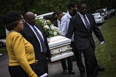 Mother wipes away tears at funeral for boy found dead on park swing.  Resurrection cemetery in Clinton, MD, June 5, 2015.- See story by DeNeen Brown of The Washington Post.