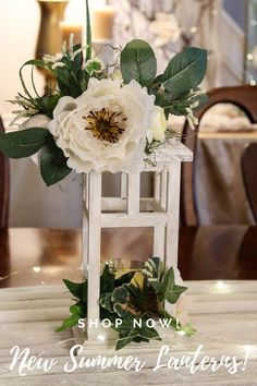 Dress up your summer tablescape with this dreamy, handcrafted wood lantern with soft pastel faux flowers. Perfect as seasonal décor or for a wedding table! Click on the link or message me for details or special requests. #indoorlanterns #tablecenterpiece #natureinspireddecor #candleholders #tablescapes #fauxflorals #homedecorations #weddingreceptiondecor Lantern Centerpieces, Lanterns Decor, Wedding Reception Decorations, Wedding Table, Table Decorations, Indoor Lanterns, Faux Flowers, Seasonal Decor, Candle Holders