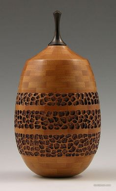 Segmented and carved vessel by Don Leman.