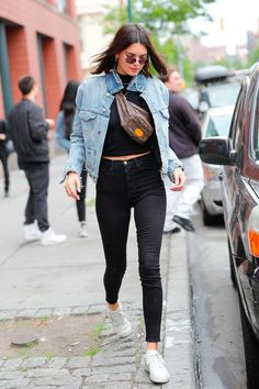 Considering Kendall Jenner's big love for all trends '80s, we're not surprised she's devoted to wearing a fanny pack. It's an easy little pouch Kendall can