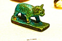 When Lower Egypt lost too many wars to Upper Egypt the Goddess Bast was morfed from a lioness to being a domestic cat...showing not so much ferocity anymore and thus Middle Kingdom came into being, reunification 2000 B.C.. (photo by Thomas Stark: Egyptian Mau spotted fur depicted as Bastet Goddess of Cats figurine)Metropolitan Museum of Art ancient Egyptian Sculptures-slide5
