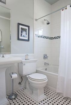 black/white mosaic floor, square tiles in shower set with brick pattern and small glass accent stripe