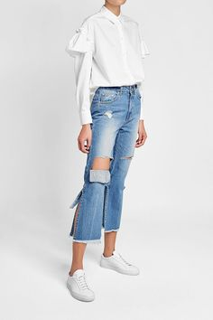 Add statement appeal to your denim edit with SJYP's flared jeans - complete with cut-out panels and an unexpected bow detail at the back. The cropped cut and light blue wash make them youthful enough to pair with worn-in sneakers #promotion