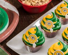 Learn how to make NFL Team Cupcakes in your team colors (doesn't have to be Green Bay Packers)