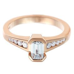 Emerald cut 0.62ct diamond and Fairtrade 9ct rose gold engagement ring