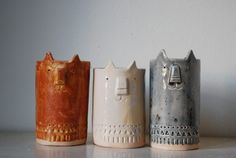 the wonkiness makes them so charming.  Ceramic Cat-Pots by Atelier Stella
