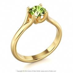 Solitaire Ring with Peridot in yellow gold. Would like this but with a pear shape stone slightly larger