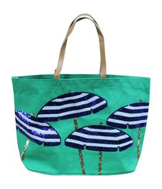 """Mud Pie Women's Fashion Maya Bay Dazzle Jute Tote Bag (Umbrella). Jute tote features sequin resort icons with vegan leather handles. Laminated wipe-clean interior and interior pocket. Size: 16"""" x 24"""" x 9"""". Choose from: Life Preserver, Umbrella, and Palm Tree. Each sold separately. From Mud Pie's Women's Fashion Bags Collection."""