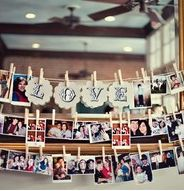 I want to do this. Either just photos of us over the past seven years on one wall, or collections of photos: us with family, us with friends, us growing up, etc. in different locations. Possibly use mini yellow clothespins? I think they have them on Amazon. And I have 70-90 free prints at shutterfly.