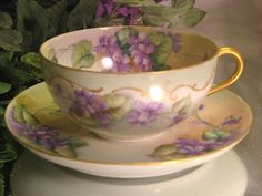 Antique limoges tea cup and saucer, circa 1900.