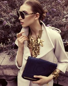 chunky golden necklace, trench and clutch