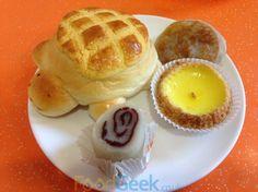 A turtle bun, peanut butter pancake, egg tart, red bean banana cake at Wong Wong Bakery, Chinatown, Manchester