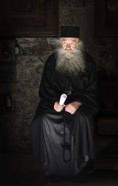 Candid portrait of Greek Orthodox priest by 6ruk, via Flickr