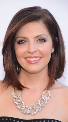 Jen Lilley wears a deep part and sleek style to the 168 Film Festival And Awards Show in Glendale, Calif.