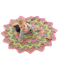 Sunburst Baby Blanket Free Crochet Pattern in Red Heart Yarns - Crochet this colorful blanket for a baby that brings a burst of sunshine into your life! Start at the center and work your way out to the 16 points. There's no seaming in this delightful design.