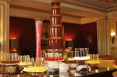 Chocolate Fountain with all sorts of fruit and cakes would be more of entertainment to the guests but also adds to the aesthetics of the event Chocolate Fountain Bar, Chocolate Fountains, Dessert Buffet, Candy Buffet, Catering Food Displays, Luxury Chocolate, Fine Dining, Delicious Desserts, Fruit
