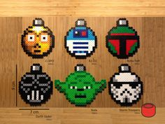 Star Wars Christmas ornaments and magnets handmade from perler beads. Characters include Yoda, Darth Vader, Storm Trooper, Boba Fett, R2-D2 and C-3PO. We