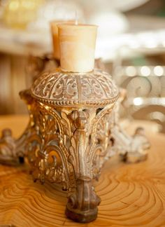 beeswax votives on on elaborate antique Venetian base, atop a rustic cedar stump ~ Heather Ross natural eclectic™