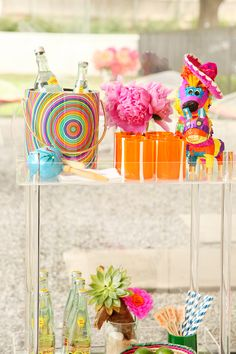 Lucite home bar with piñata and peonies