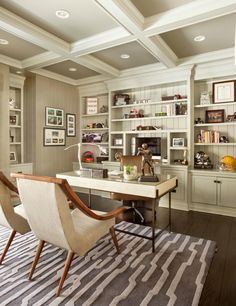 this massive home office features the bright contrast between dark stained hardwood flooring and white walls and rich cabinetry and shelving above chic home office features