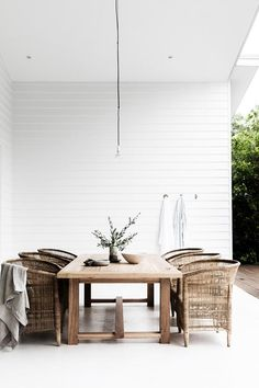 Family and friends regularly kick back in the rattan chairs around the outdoor table by Sheoak Design | Photography: Maree Homer | Styling: Kerrie-Ann Jones
