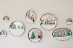 These cake pan dioramas are a fun way to display small ornaments or figurines. I have some little wooden ornaments, pine cone elves, and putz houses that are sometimes hard to see if I put them with my other decorations. By making little winter scenes in these cake pans, I can feature my favorite vintage ornaments, and really make them stand out. I have a cluster of these cake pan dioramas over my bed, and I love that festive display. I think one of these dioramas would also make a…