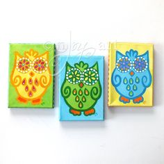 """3 Funky Owls, Set of 3 5""""x7""""x.75"""" acrylic paintings of flower eyed owls by nJoyArt. Ready to ship original art. This set of 3 funky owls are great for adding color and whimsy to any room. They would be cute in a kids room or baby nursery but really could hang in any room of the home or office that could use a bit of cheer. The decorative owls are painted in bright yellow, green and blue on alternating backgrounds, the frame edges of each canvas are panted in coordinating colors and…"""