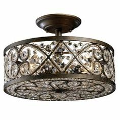 "Wrought iron semi-flush mount with crystal embellishments.    Product: Semi-flush mount   Construction Material: Wrought iron and crystal   Color: Antique bronze  Features: Modern drum shape   Will enhance any decor Accommodates:  (4) 60 Watt candelabra base bulbs - not included  Dimensions: 10"" H x 13"" Diameter"