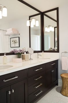 Jennifer Worts Design Modern espresso bathroom design with espresso double vanity, chrome modern pulls hardware, marble countertops, espresso stained framed mirrors, penny tiles floors and soft blue gray walls paint color.