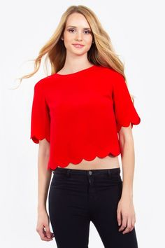 42ad89369d059f Bright cherry red top with scalloped edge at the bottom and sleeves. Button  closure in the back. Wear with culotte pants or skinny jeans.
