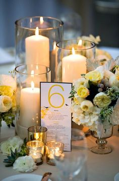 Candles/flowers mix. Mirrors on table.