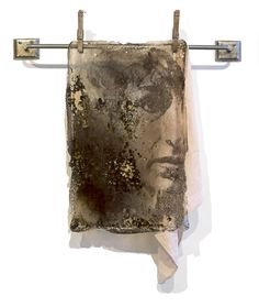 Sally Mankus - mixed media - a translucent acrylic skin (with embedded rust and carbon from charred bakeware), image transfer and found objects, 24 x 20 inches