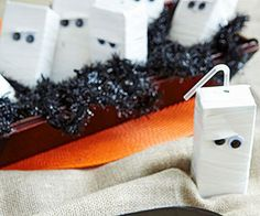 Make an army of mummies by wrapping juice boxes in white electrical tape and adding adhesive-backed googly eyes. (Be sure to punch out a hole in the tape for the straw!) ADORABLE!!