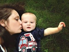 Mother son baby photo in grass.