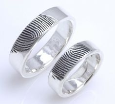 Fingerprint Ring. These would make really cool wedding bands.