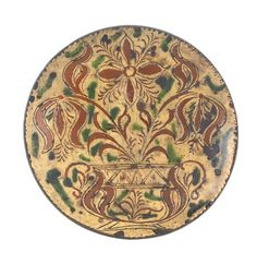 Sold For $ 22,000         	   	        	   	           	      	                  Bucks County, Pennsylvania sgraffito redware charger, ca. 1810, attributed to Conrad Mumbauer, decorated with a potted tulip, 11 3/4'' dia. Illustrated in Beatrice B. Garvan, The Pennsylvania German Collection, pg. 185, fig. 70.                            Condition report           Sporadic glaze loss, several old chips to rim.